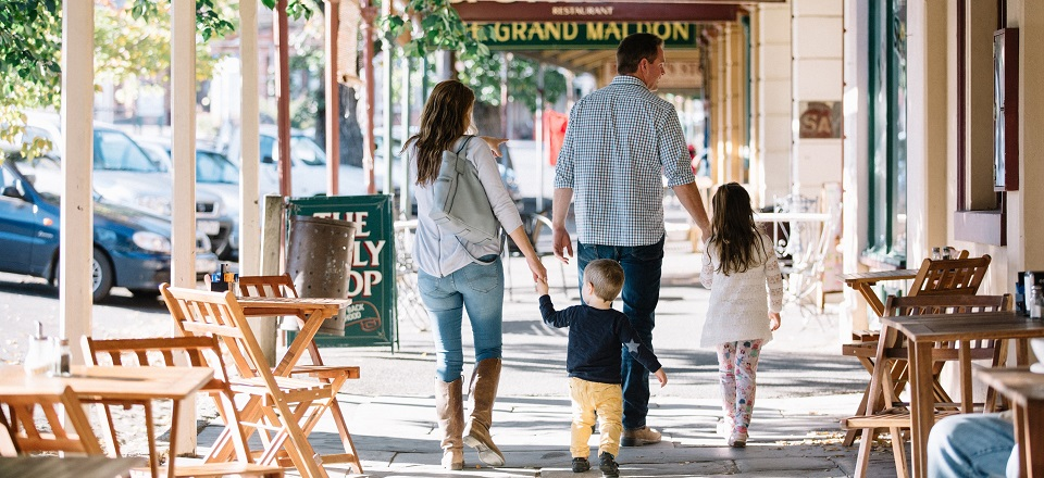 Image: Family walking down historic street in Maldon.  Link to child page: New residents