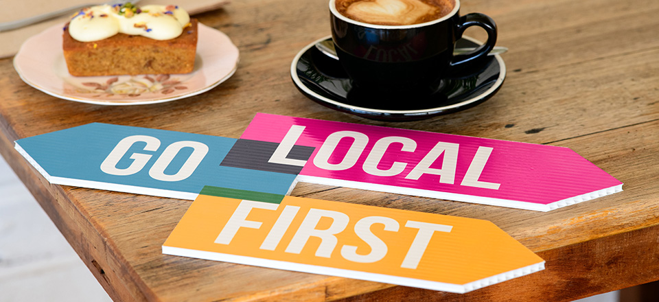 Go Local First logo on table