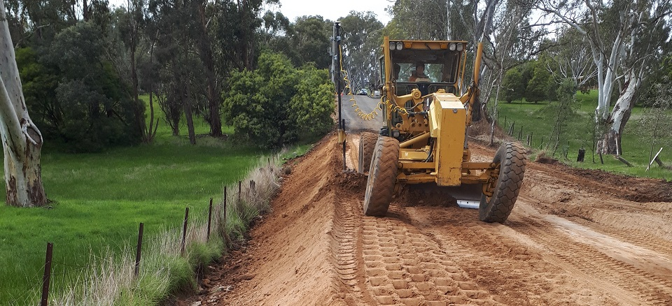 Image: Heavy vehicle grading rural road.  Link to child page: Capital works