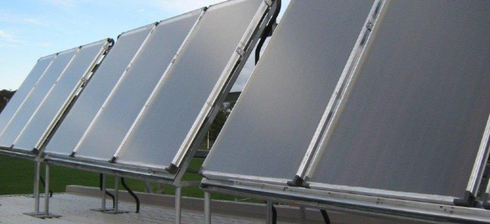 Image: Solar hot water system on community building  Link to child page: Community plans