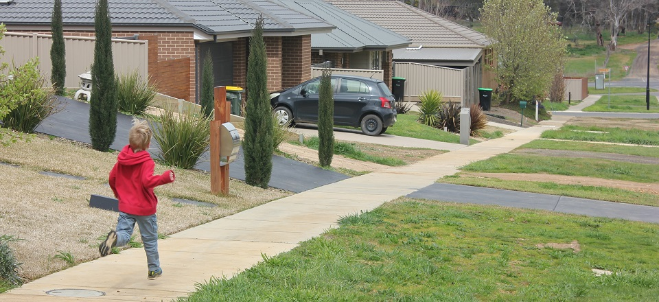 Image: Boy running in new housing estate in McKenzie Hill near Castlemaine.  Link to child page: Rates, valuations and payments