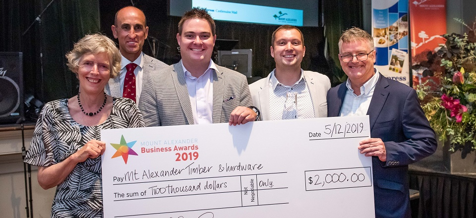 Image: Mt Alexander Timber & Hardware with large prize money cheque of $2000.  Link to child page: Business grants and funding
