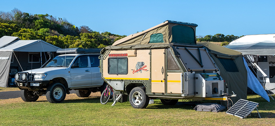 Image: Four wheel drive and caravan at a caravan park  Link to child page: Caravan Parks