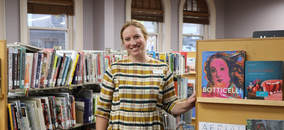 Image: Jess standing in front of book shelves at the Castlemaine Library.  Link to child page: Library Services