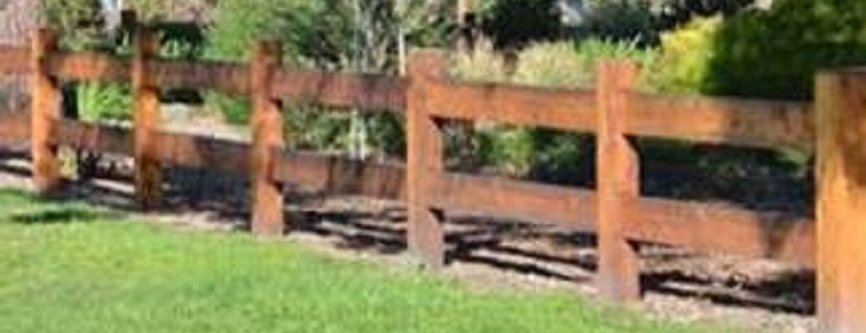 Photograph showing a post and rail fence.